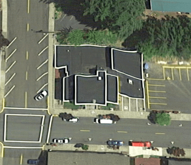 The building's lines are distorted from above show a complicated layout. (Google Maps)