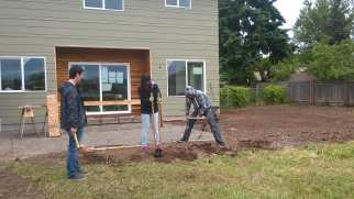 Students digging fence posts holes