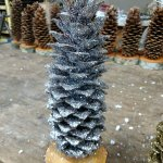 silver glittered pine cone christmas tree