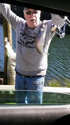Local Fisherman Tony Thomas catching trout at Big Creek in Newport