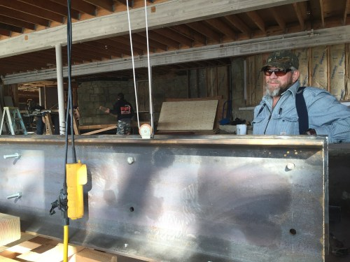 Ron Trevillian, of Trevillian Construction, oversees the installation of steel roof support beams in the Doerfler Family Theater. (courtesy photo)