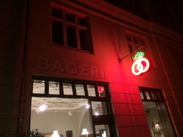 Det Rene Brød's red neon bageri sign illuminates Rosenvængets Allé