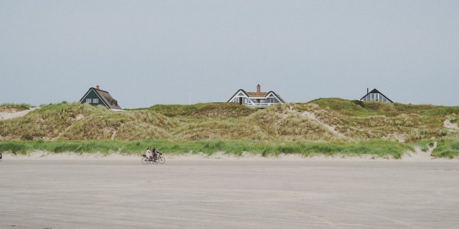 Bicycles on the Fanø island beach and summer houses in the Dunes
