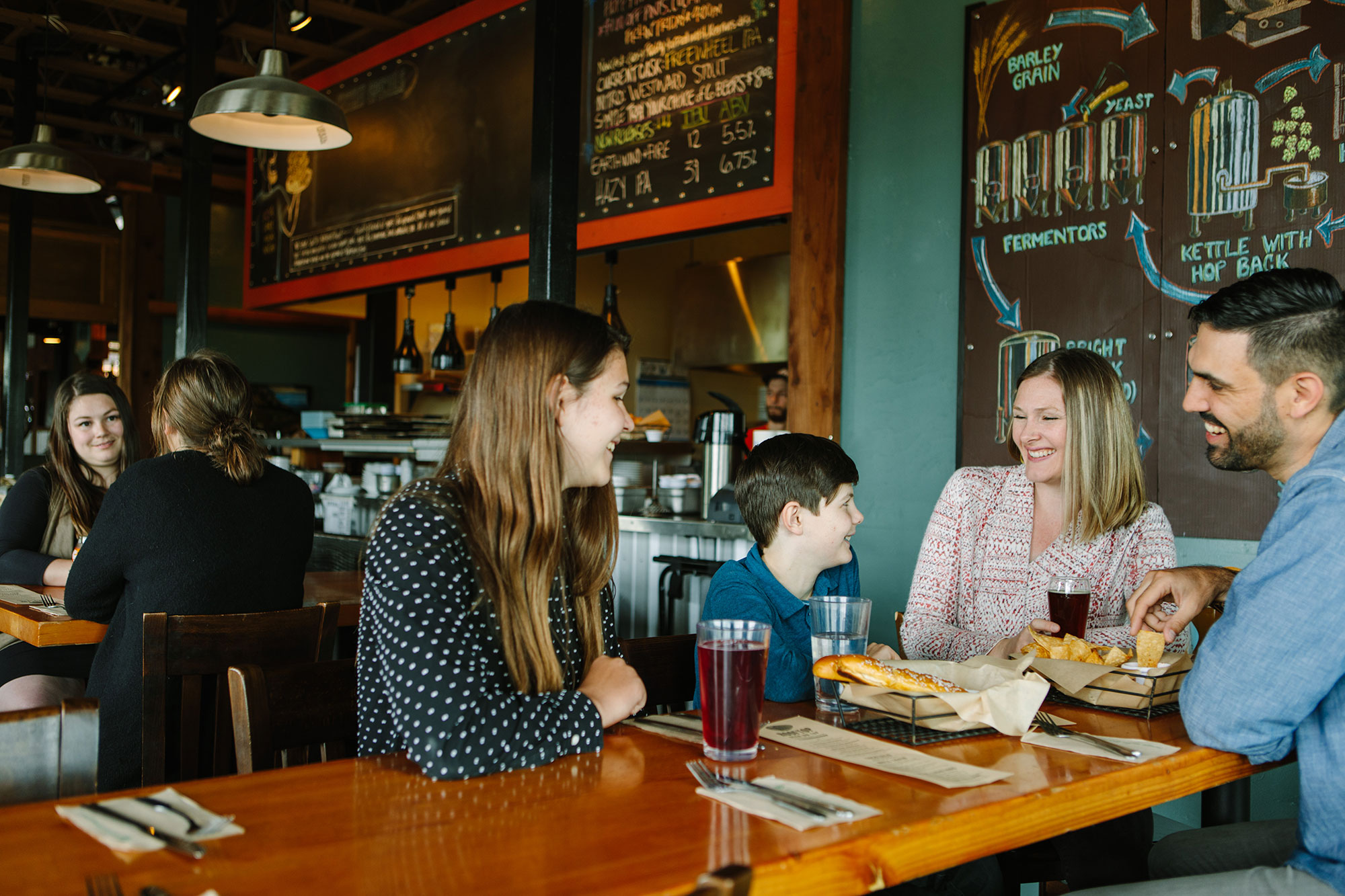 Families eating in a downtown Corvallis brewpub.