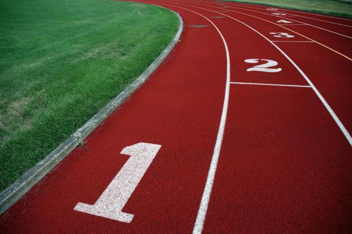 Oregon Senior Games - Track & Field - Closeup on a numbered, red running track