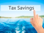 Tax Savings - Hand pressing a button on blurred background conce
