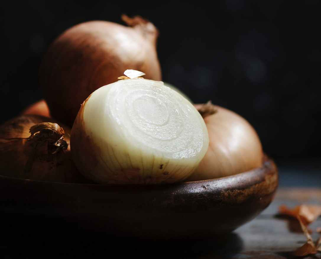 brown onion on brown wood plate