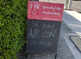 Sign advertising air-conditioning on a hot day