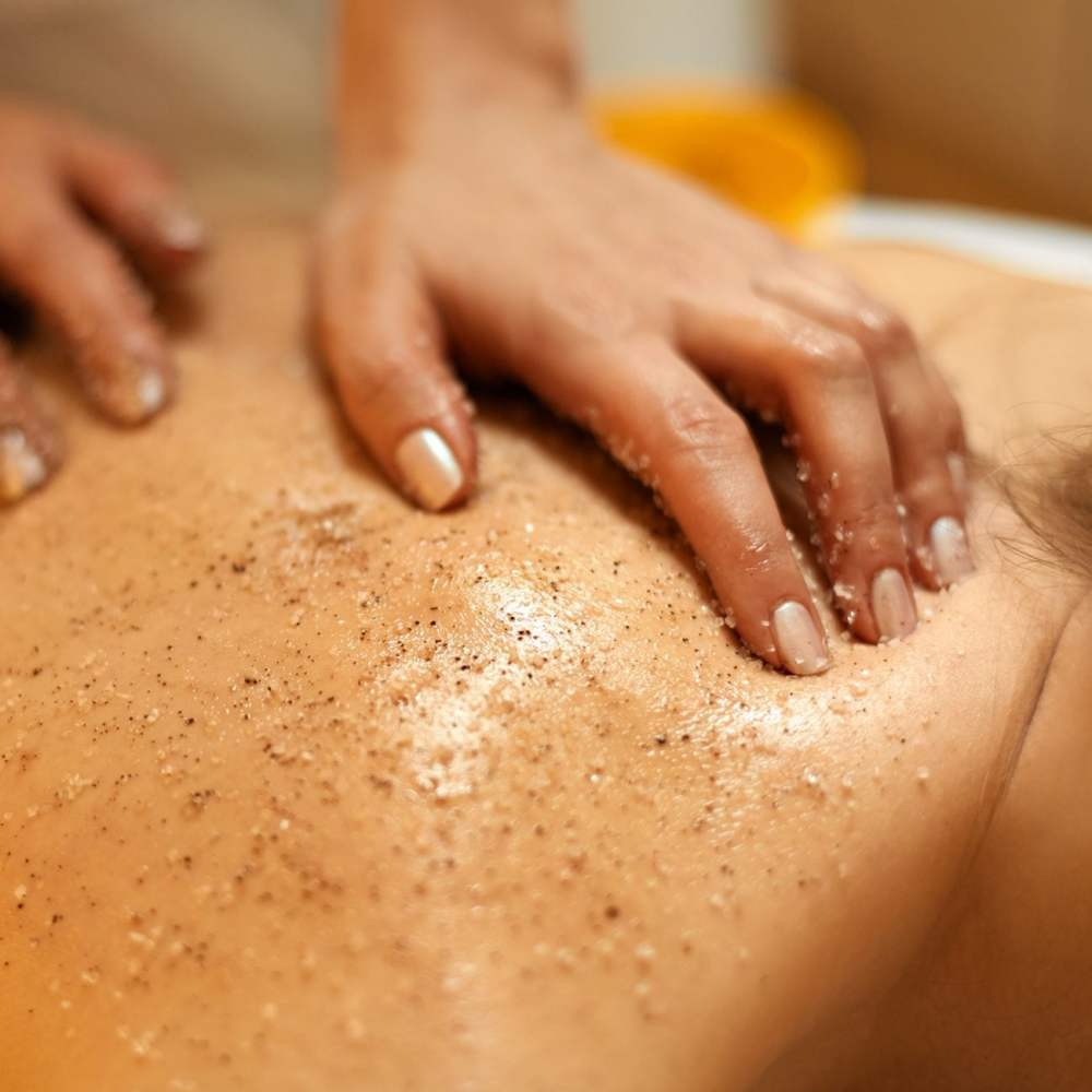 Body Scrub. Beautiful Blonde Gets a Salt Scrub Beauty Treatment