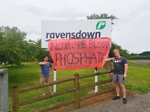 """Two OA members in Auckland attach banner outside Ravensdown that reads """"No more blood phosphate. #FreeWesternSahara."""""""