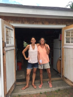 Mother and daughter team in front of the finished, organized garage.