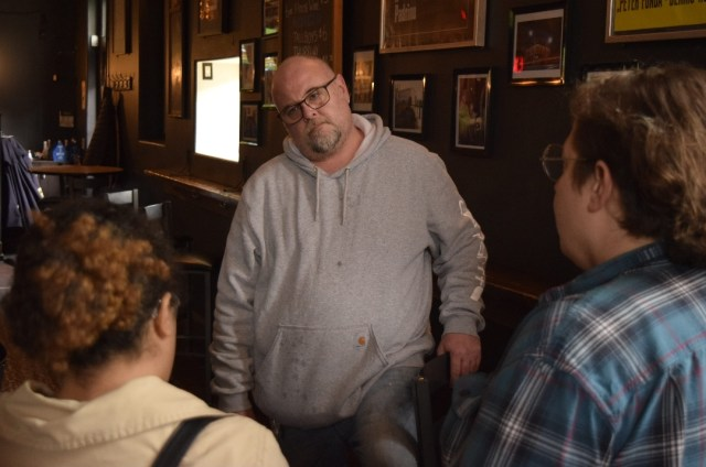 Hamilton Reclaim Your Pay campaign confronts owner of Gallagher's Bar over stolen wages, November 2018 | Image courtesy Hamilton IWW