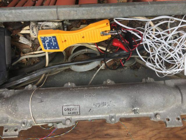 Telephone test set and IWW graffiti | Image courtesy of the author