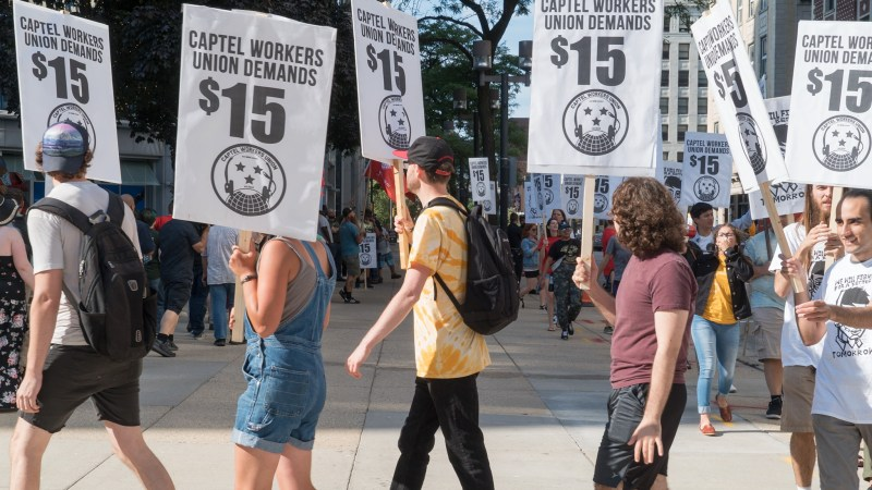 CapTel workers and supporters picket the company's Milwaukee offices.