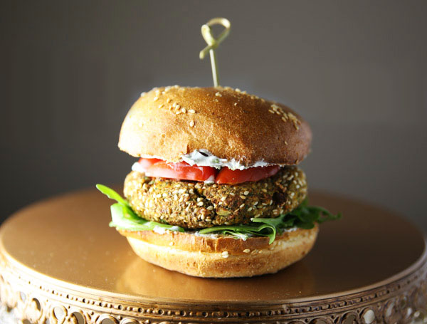 This Easy Veggie Burger topped with a Greek Yogurt Mint Sauce is super tasty, this will seriously be your new favorite burger!