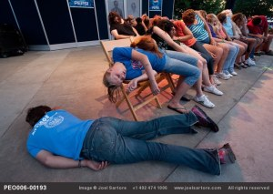 Volunteers go catatonic at the snap of a hypnotist's fingers at the Iowa state fair. (Image ID: PEO006-00193)