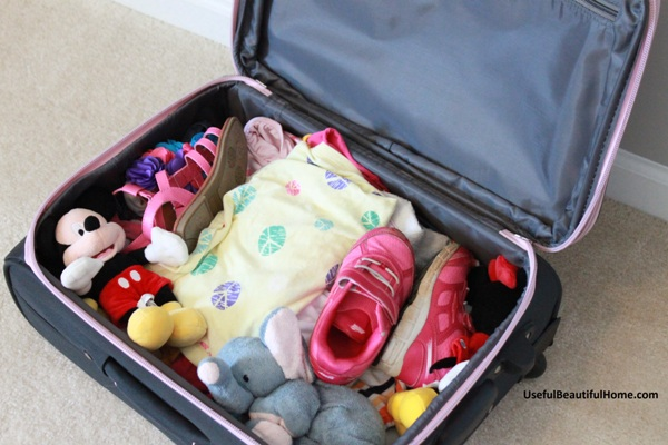child packed suitcase