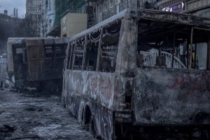 """Police buses burnt by """"peaceful pro-European protesters"""" in Kyiv. Photo taken on January 20, 2014."""