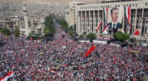 Syrians rally in Damascus in support of President Bashar al-Assad, October 2011