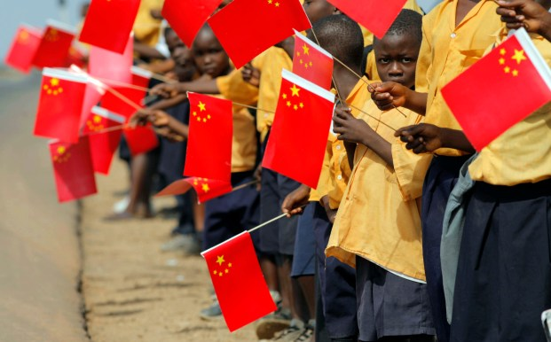 Liberian children hold Chinese flags