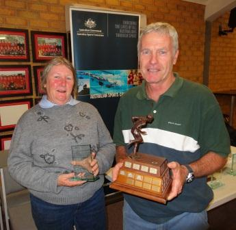 Liz Bourne and Reid Moran accept the Silva Award for Services to Orienteering in Australia on behalf of Fiona Calabro.