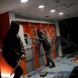 Demonstrators crash an ATM machine during a protest against President Michel Temer's proposed reform of Brazil's social security system, in Sao Paulo