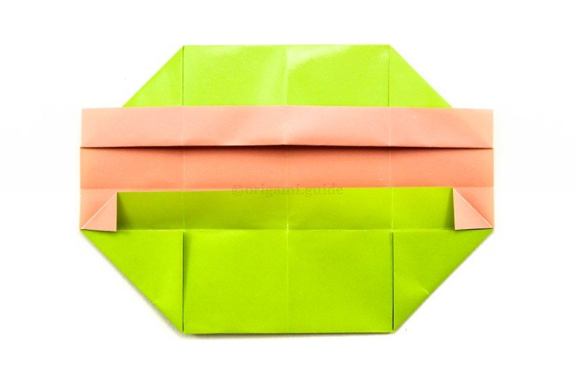 16. You can also unfold the two previous steps and fold the left and right corners in before re-folding.