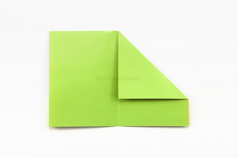 5. Fold the top right corner down to the left diagonally, aligning with the central crease.