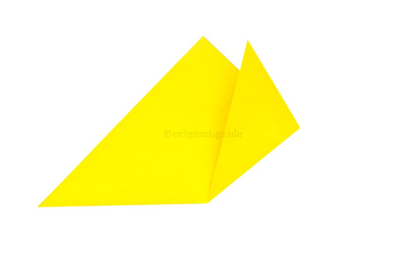 5. Take the right point and bring it up and to the right at an angle away from the top point.