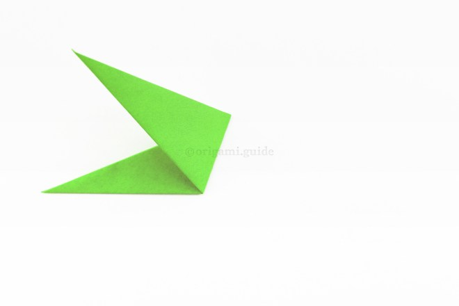 9. Fold the right of the shape up and to the left at an angle, it will be guided by inner flaps inside.