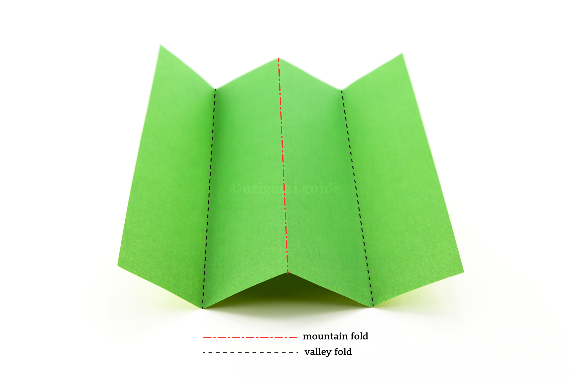 How To Make Origami Mountain & Valley Folds | Origami Guide Valley Fold on origami paper, pureland origami, miura map fold, origamic architecture, cootie catcher, chinese paper folding, mathematics of paper folding, modular origami, crease pattern, thousand origami cranes, rigid origami,