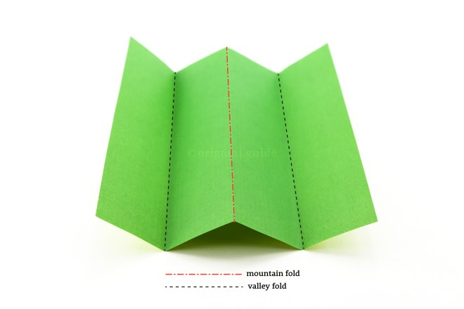 1. Here is a sheet of paper with a mountain fold in the middle, on the left and right are valley folds.