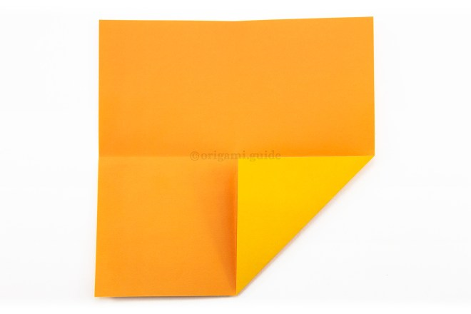6. Fold the bottom right corner to the center of the paper.