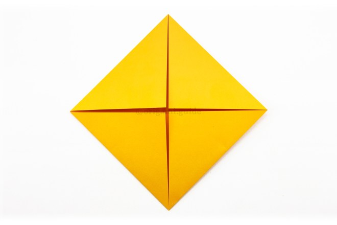 7. Fold the remaining three corners to the center.