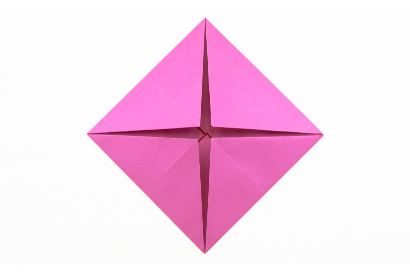 10. Fold the other three corners to the middle of the square.