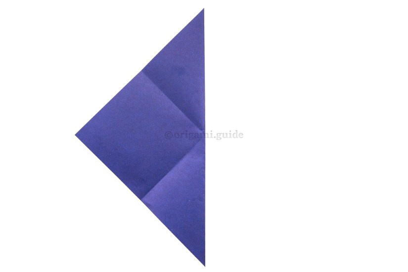 8. Fold the right corner over to the left corner.