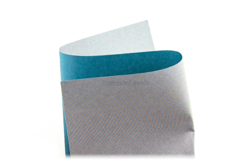 3. You will need to divide the paper into thirds. This is the 'S' method, pick up the paper and make it an S shape, until the paper becomes equally divided into thirds.