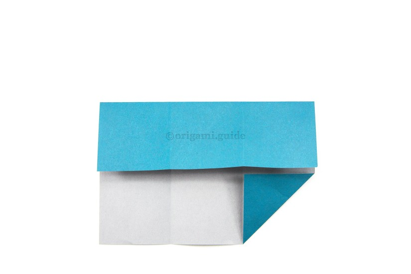 11. Fold the top edge down to align with the top of the flap you created in the previous step.