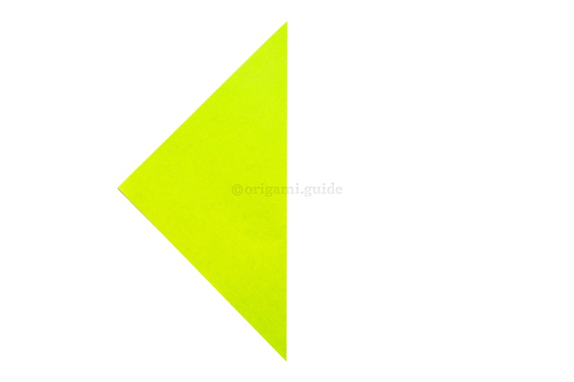 3. Create a central vertical crease by folding the right point over to the left point.