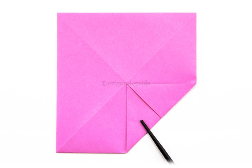 9. Again, fold the bottom right corner to the very center of the paper.