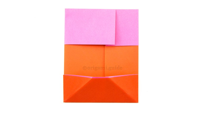 10. Fold the bottom edge up using the top of the diagonal creases you just made as a guide.
