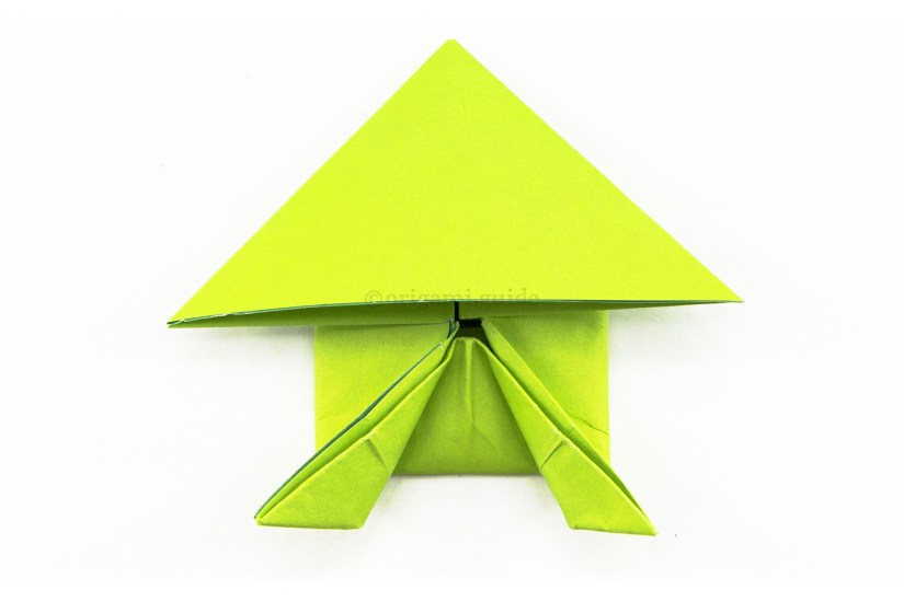 21. To make the frog's back legs, fold the points diagonally outwards.