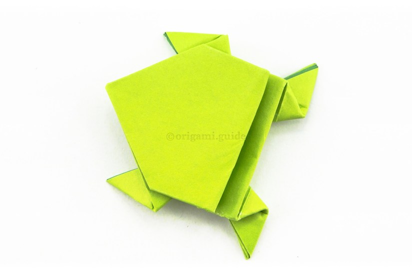 25. The origami frog is complete, use your finger and hold the back edge down and the frog will spring up and away.