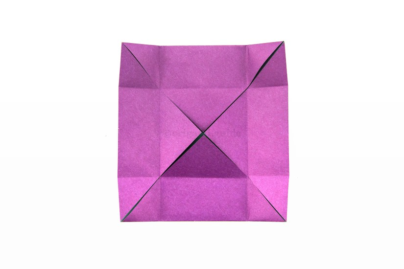 15. Unfold the left and right edges.