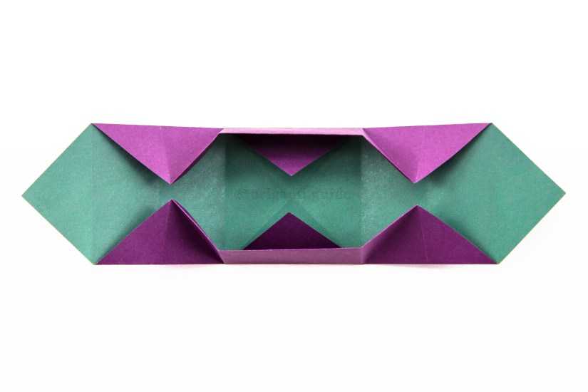 18. Open up the middle section, fold the left and right section upwards as well.