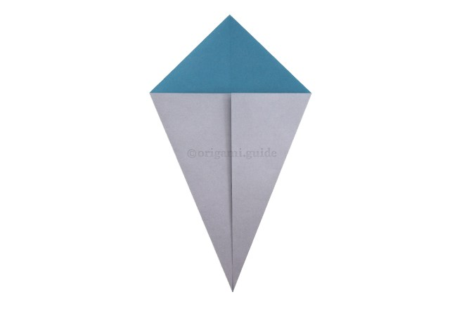 5. Fold the lower left and right diagonal edges to align with the central vertical crease.