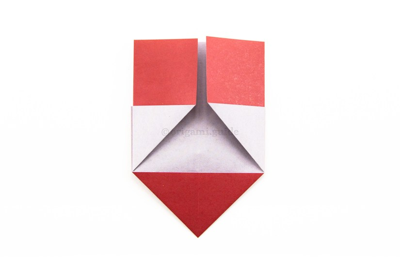 12. Fold the left and right edges to meet in the middle.