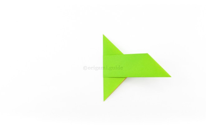 7. Fold the left section over to the right, aligning the wings together.
