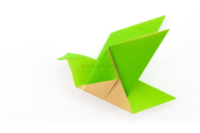 13. Open the beak shape out and reverse fold it inside.