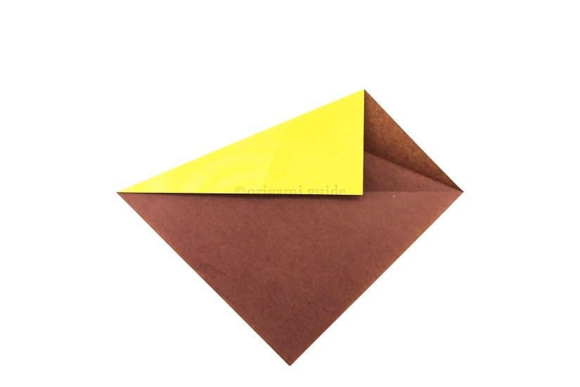 6. Repeat the same fold on the top left diagonal edge.